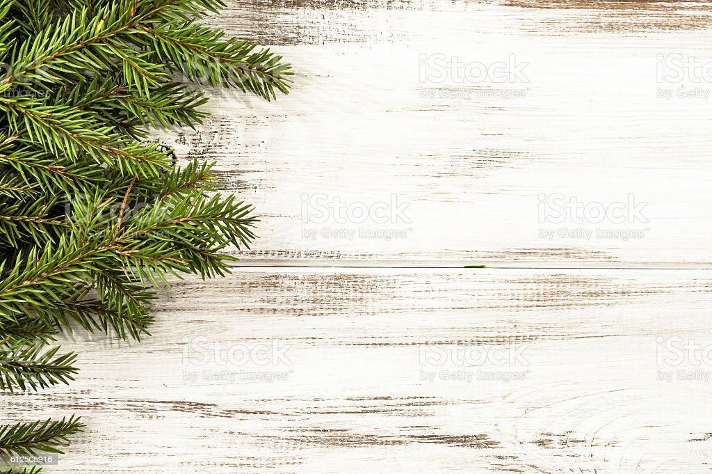 Christmas tree branch on wooden background useful as christmas decoration. stock photo