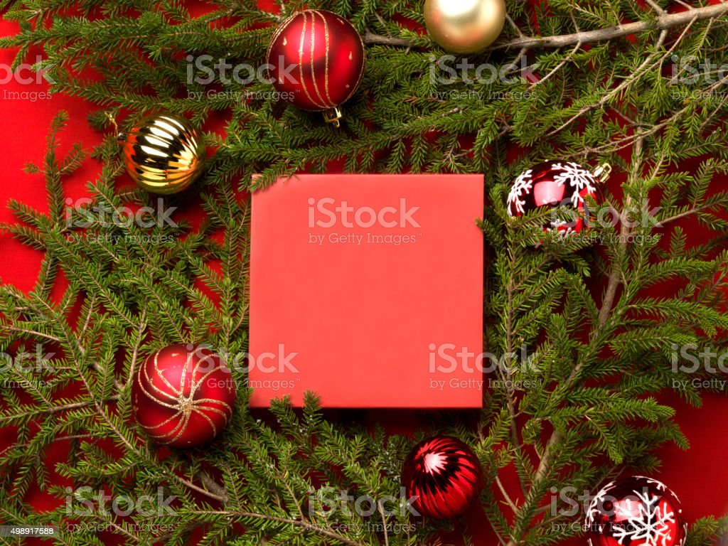 Christmas tree branch with baubles and gift stock photo