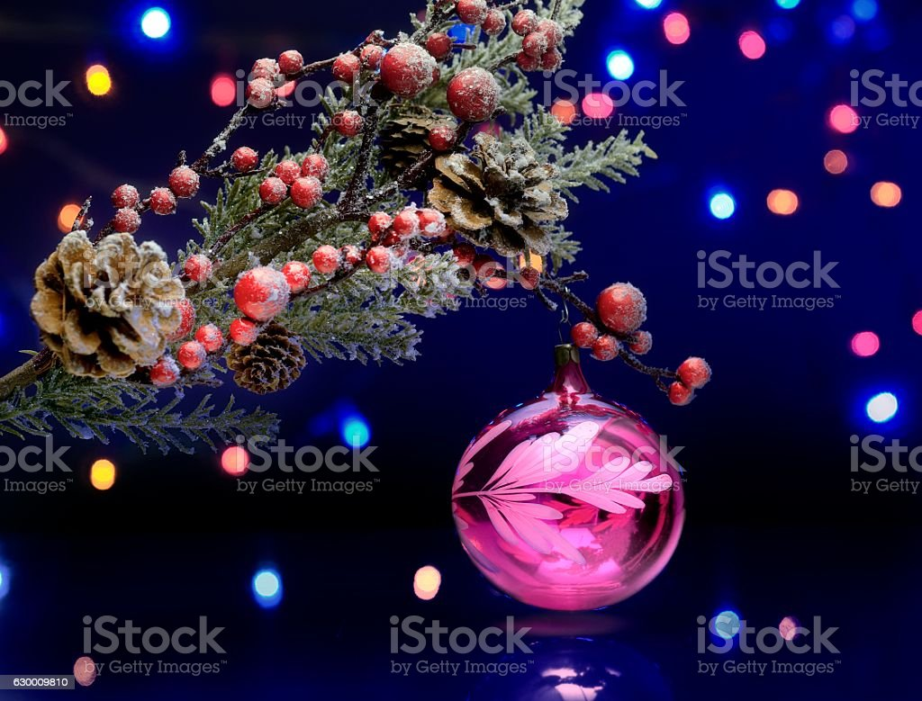 Christmas tree branch with decoration ball. Sparkling and fairy background stock photo