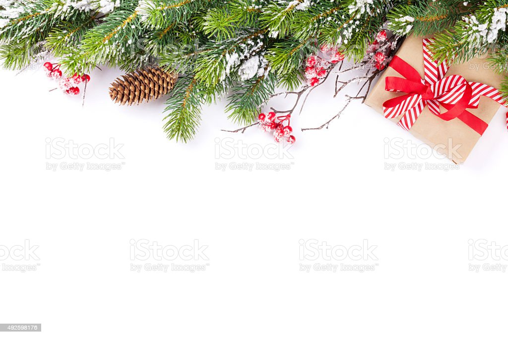 Christmas tree branch with gift box stock photo