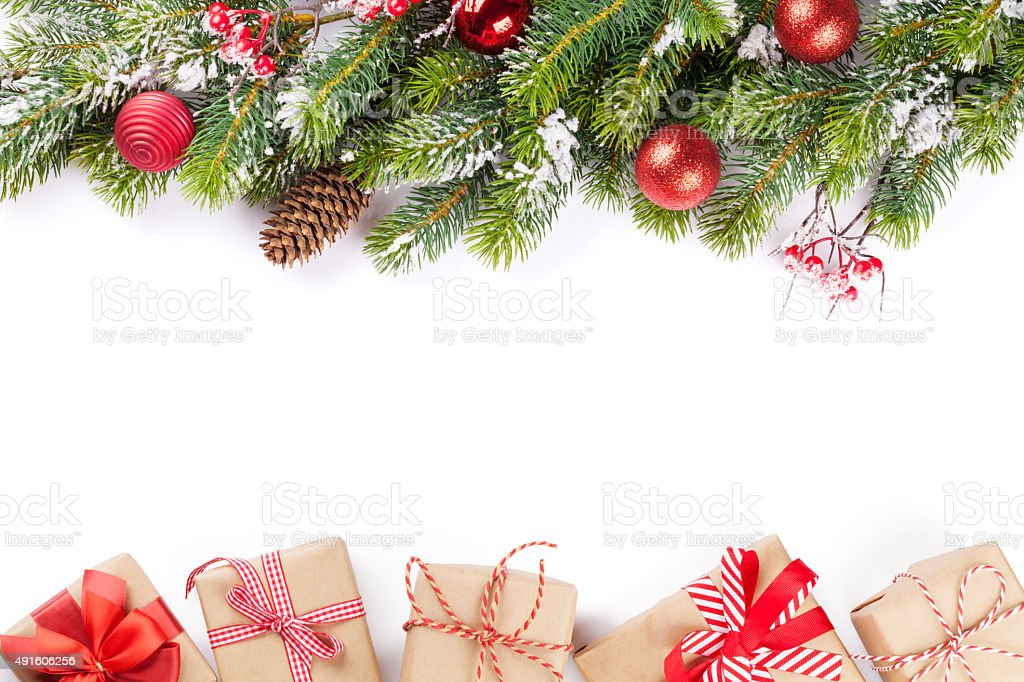Christmas tree branch with gift boxes stock photo