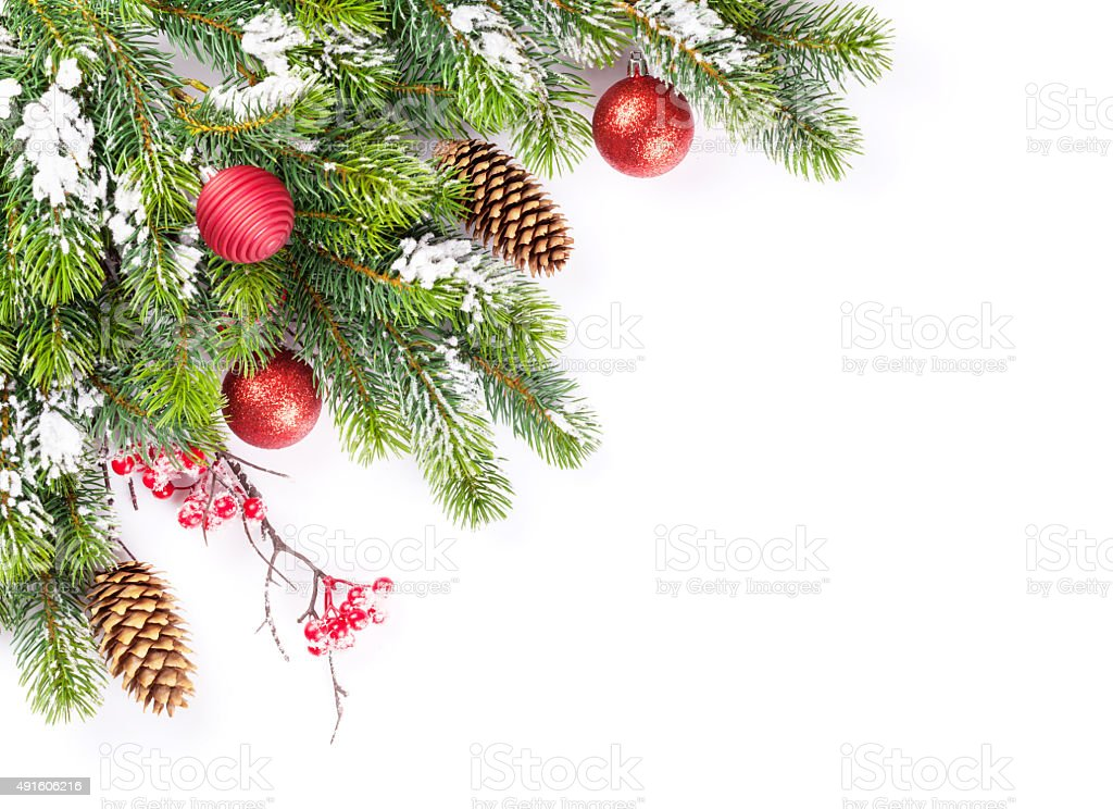 Christmas tree branch with snow and baubles stock photo