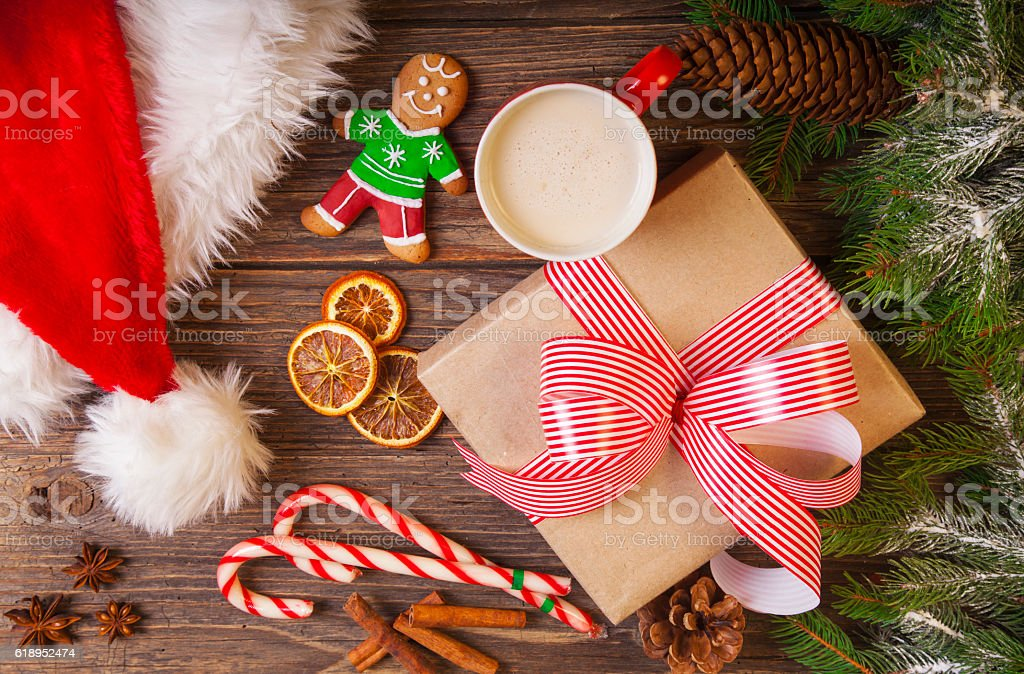 Christmas tree branch with snow and gift box stock photo
