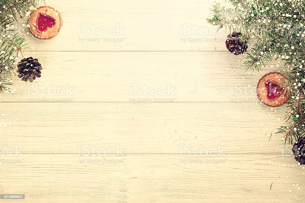 Christmas tree branches on wood background stock photo