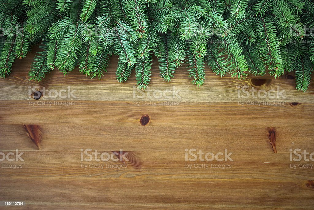 christmas tree branches over wooden board royalty-free stock photo