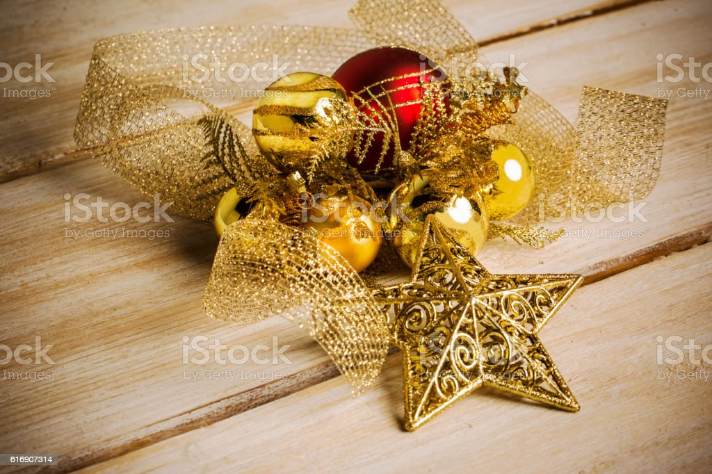 christmas tree branches with golden garlands on wood stock photo