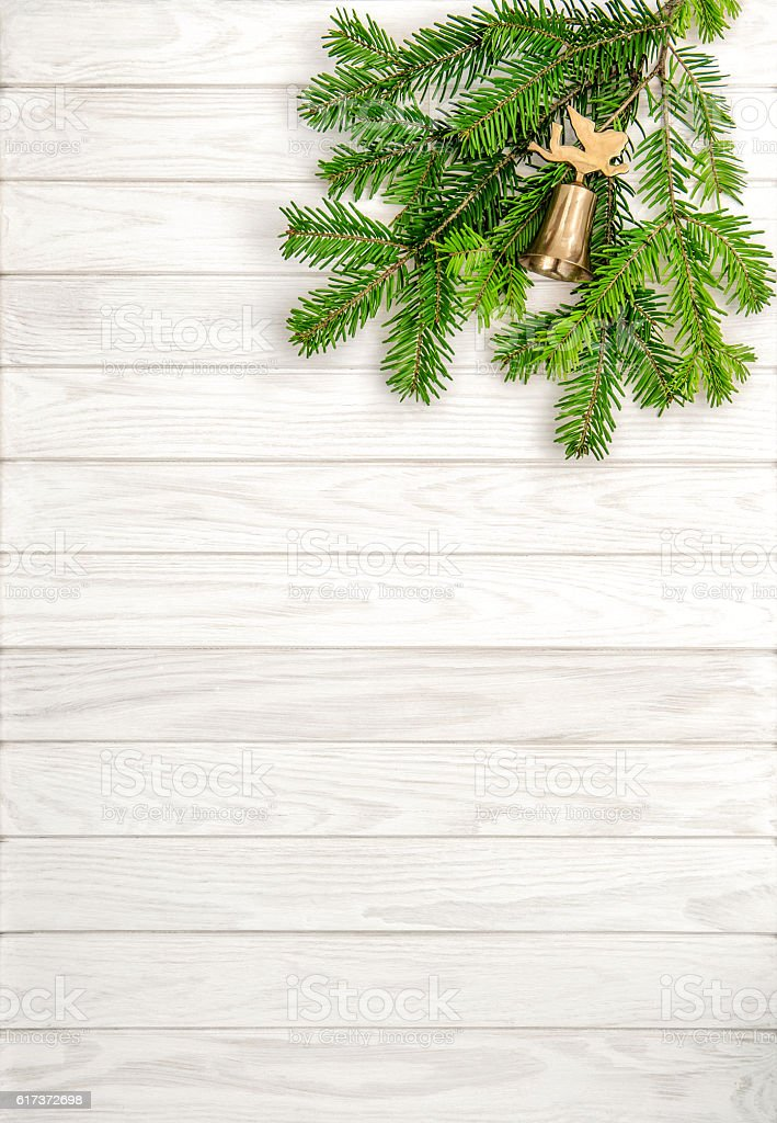 Christmas tree branches wooden background stock photo