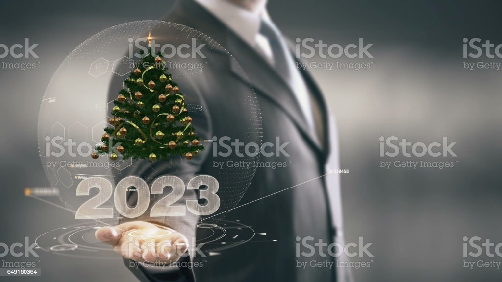 2023 Christmas tree Businessman Holding in Hand New technologies stock photo