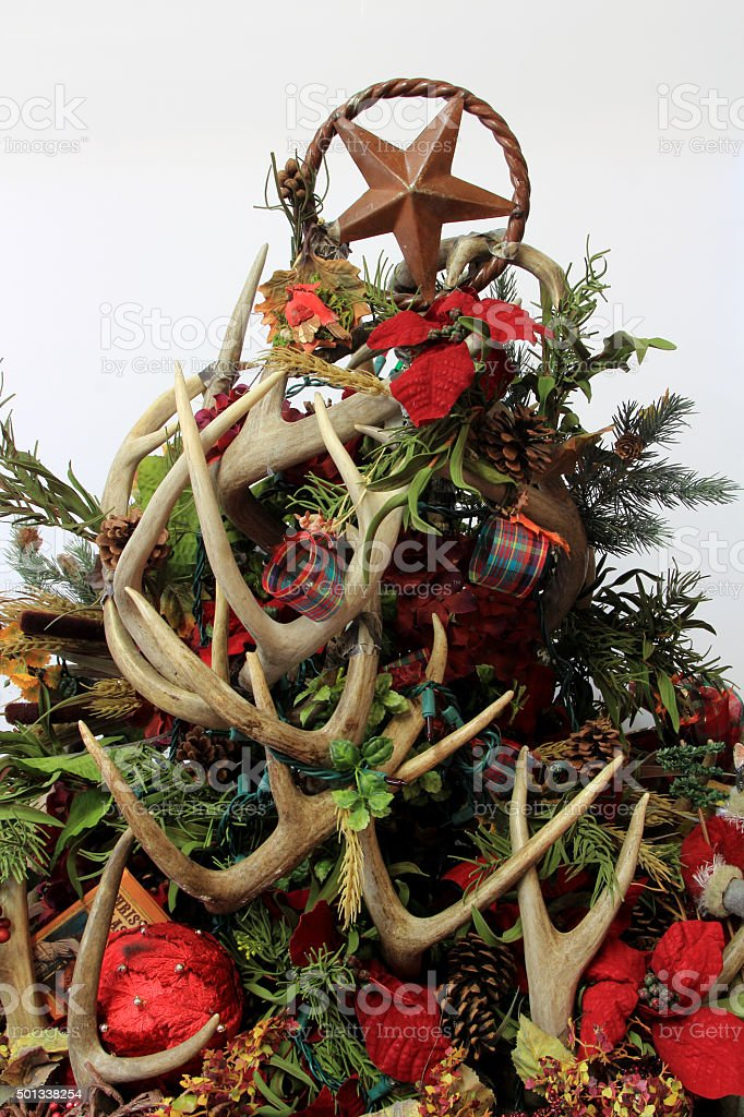 Christmas tree centerpiece decoration made of deer antlers stock photo