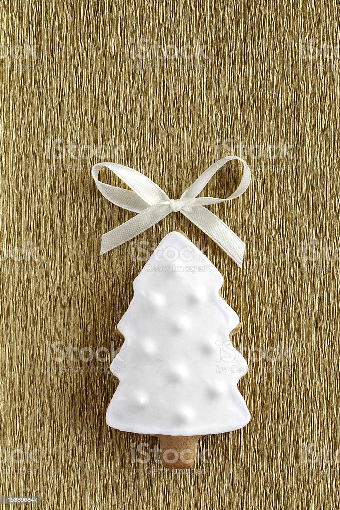 Christmas tree cookie on the gold background. royalty-free stock photo