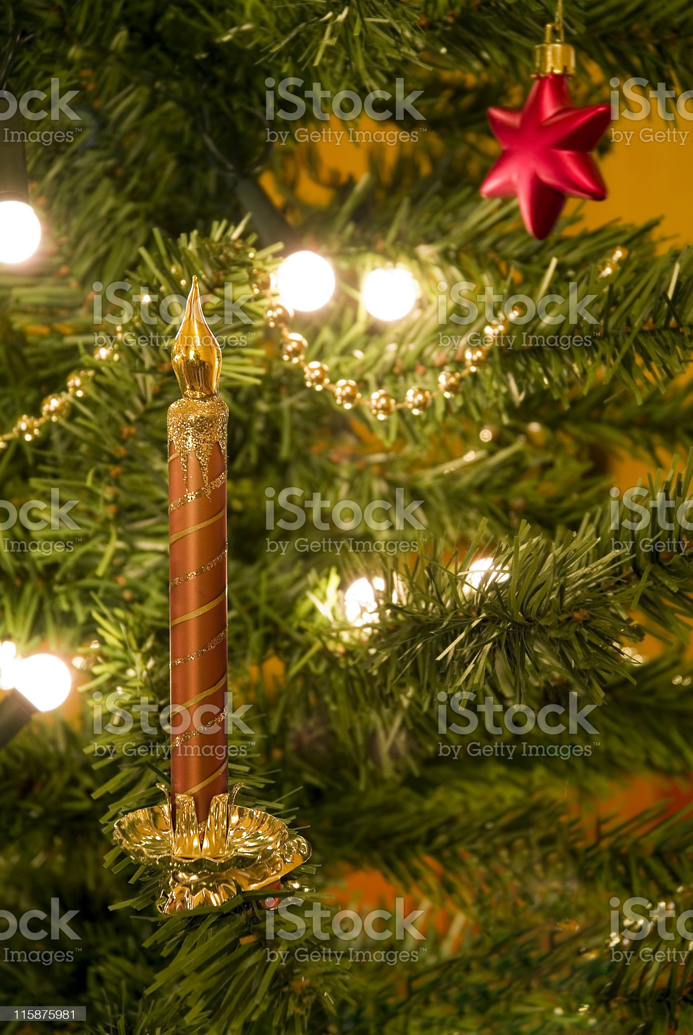 Christmas tree decorated with candle ornament royalty-free stock photo
