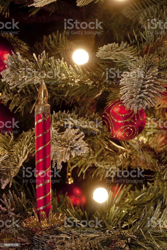 Christmas tree decorated with candle ornament stock photo