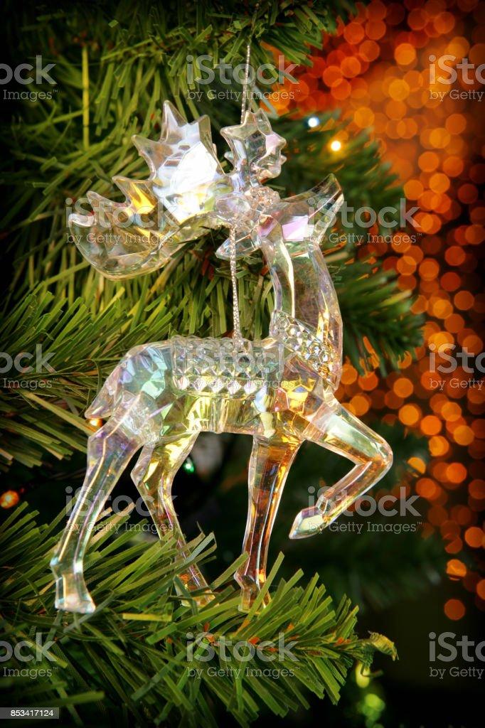 Christmas tree decoration (glass deer) with blur lights stock photo