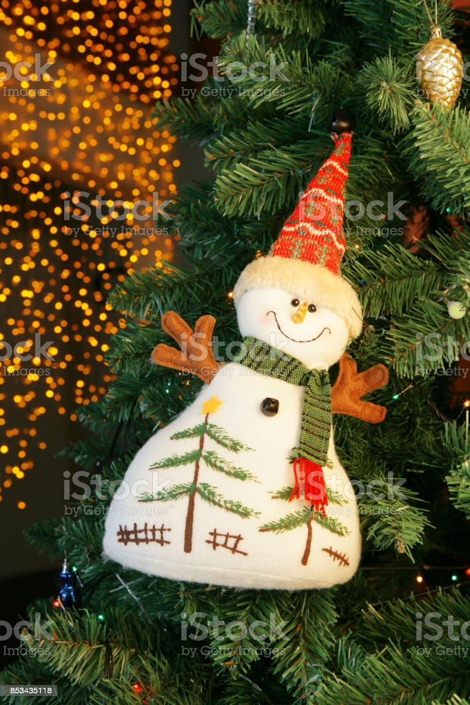 Christmas tree decoration (pretty snowman) with blur lights stock photo