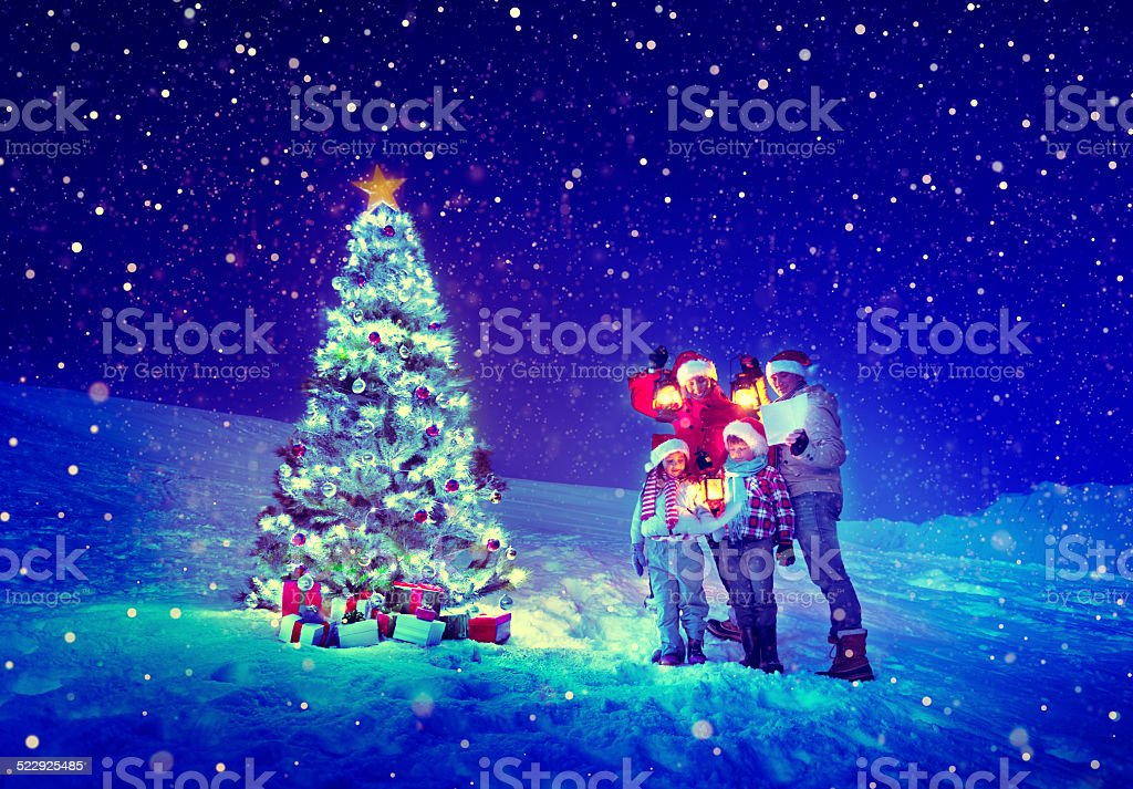 Christmas Tree Family Carol Snow Concept stock photo