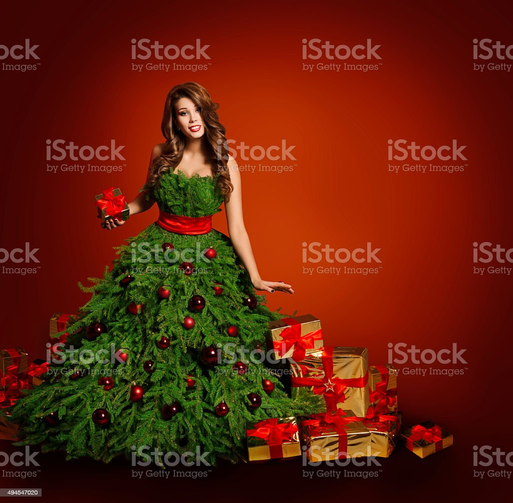 Christmas Tree Fashion Woman Dress, Model Girl Presents Gift, Red stock photo