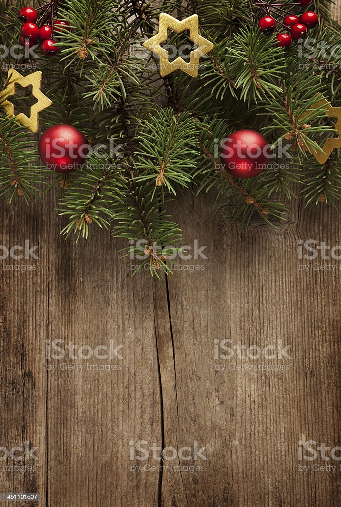 Christmas tree garland with ornaments against wood royalty-free stock photo