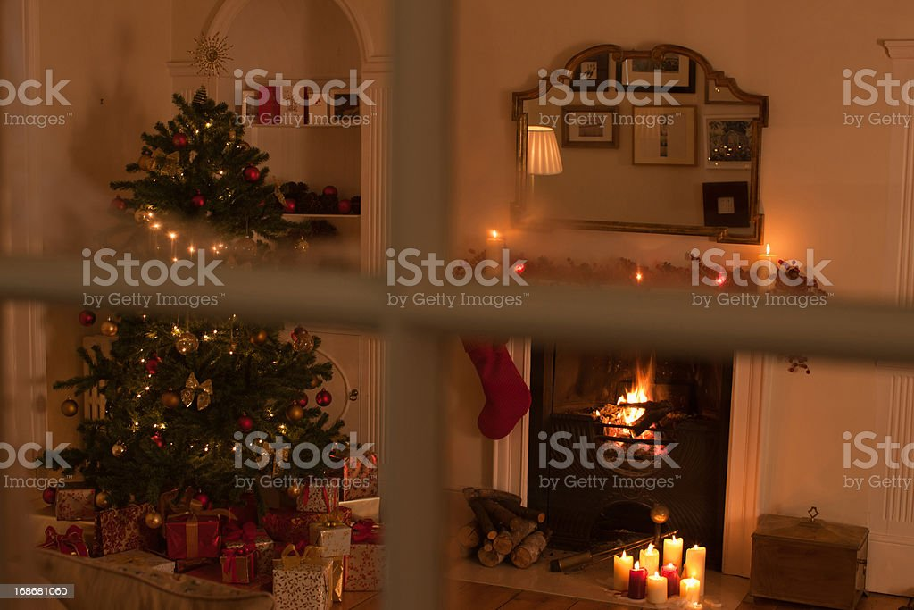 Christmas tree in living room behind window royalty-free stock photo