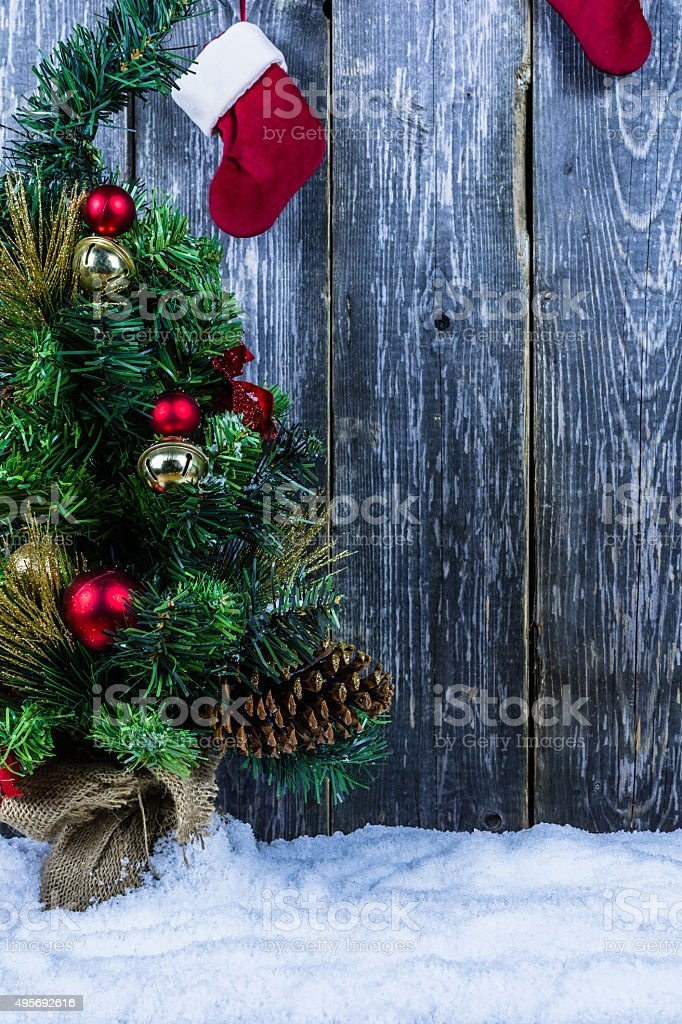 Christmas Tree in Snow, Santa's Boot's, Christmas Background stock photo