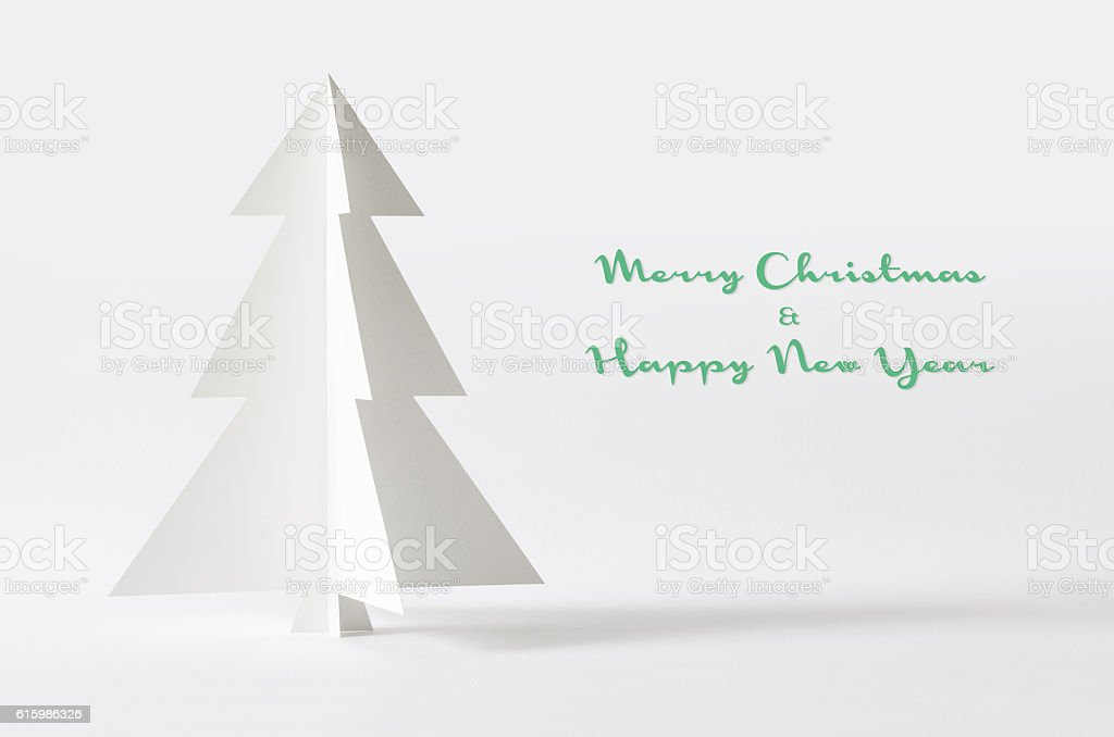 Christmas tree isolated on white background. Christmas tree pape stock photo