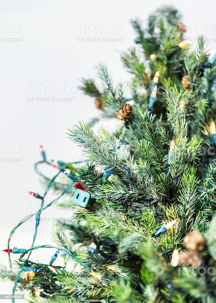 Christmas Tree Lights Plug Twisted Wires Close-Up From Below stock photo