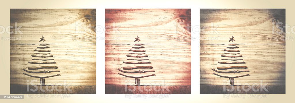 Christmas tree made from dry sticks on wooden stock photo