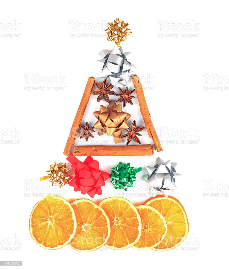 Christmas tree made of anise, cinnamon and dried oranges. stock photo