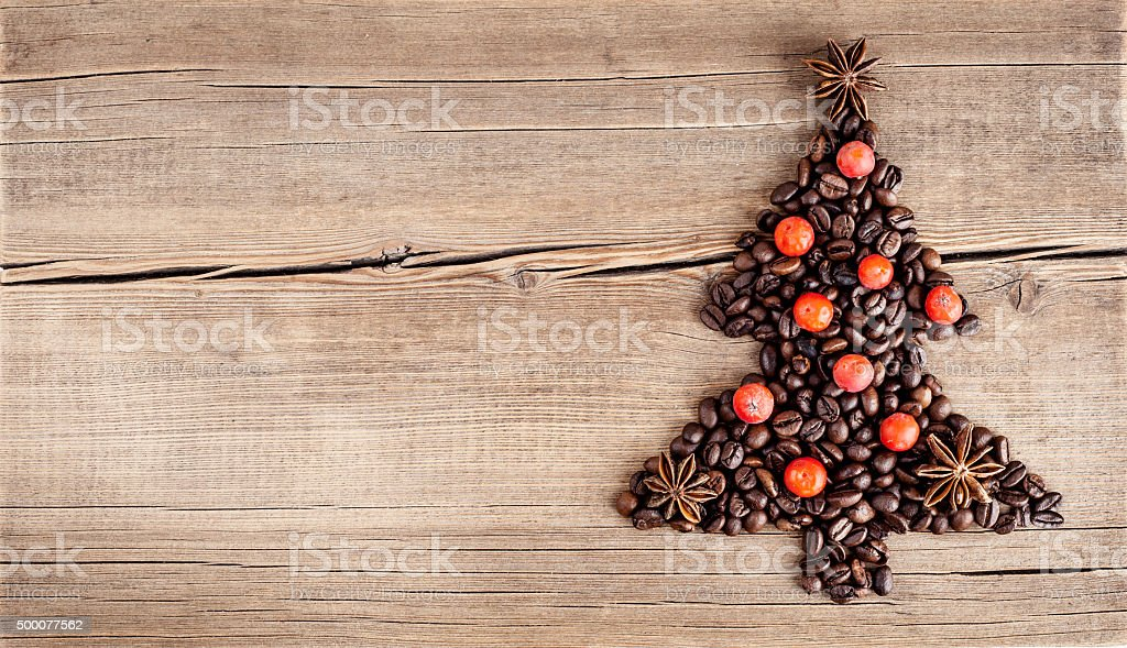 Christmas tree made of coffee beans on wooden table stock photo