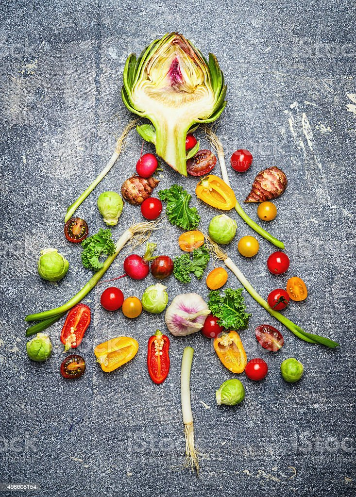 Christmas tree made ​​of fresh vegetables on gray rustic bac stock photo