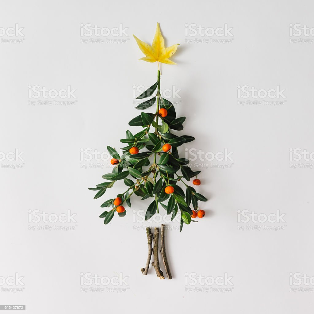Christmas tree made of leaves and berries stock photo