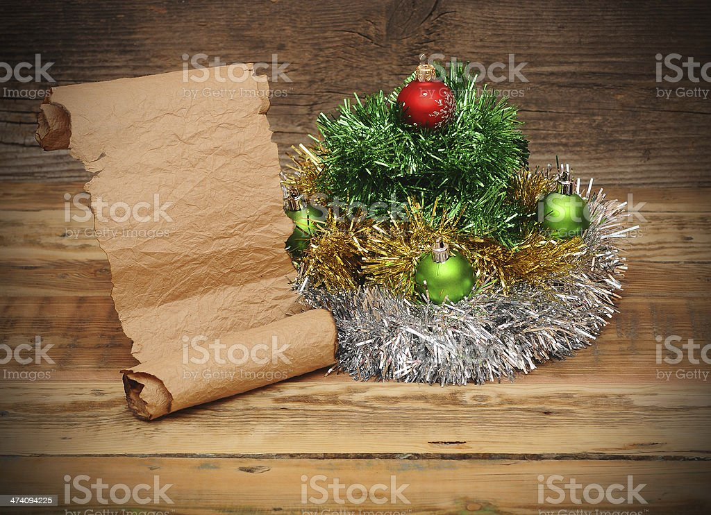 Christmas tree made of tinsel with old paper scroll royalty-free stock photo