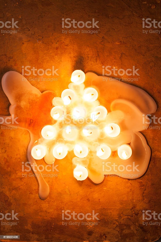 Christmas tree made with lighted candles stock photo