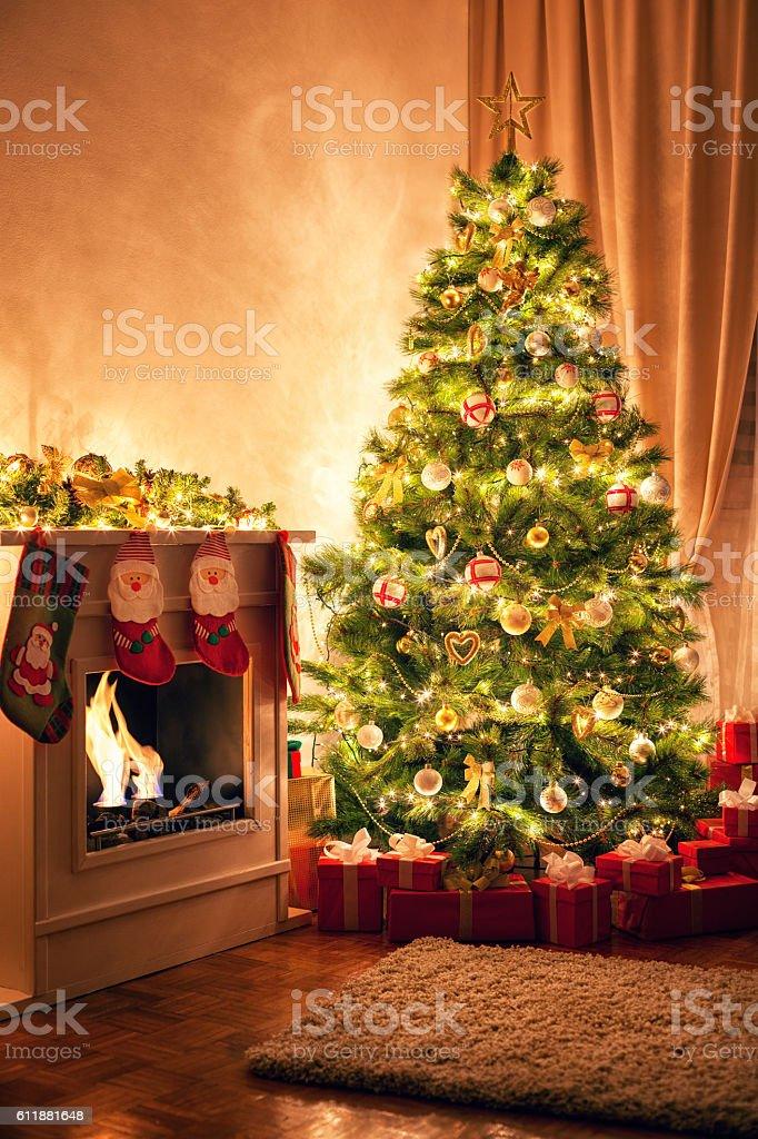 Christmas Tree near Fireplace stock photo