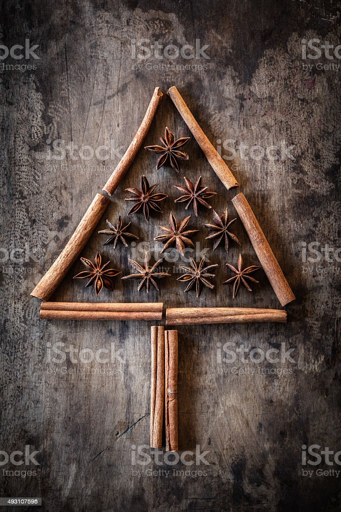 Christmas tree of cinnamon sticks and star anise stock photo