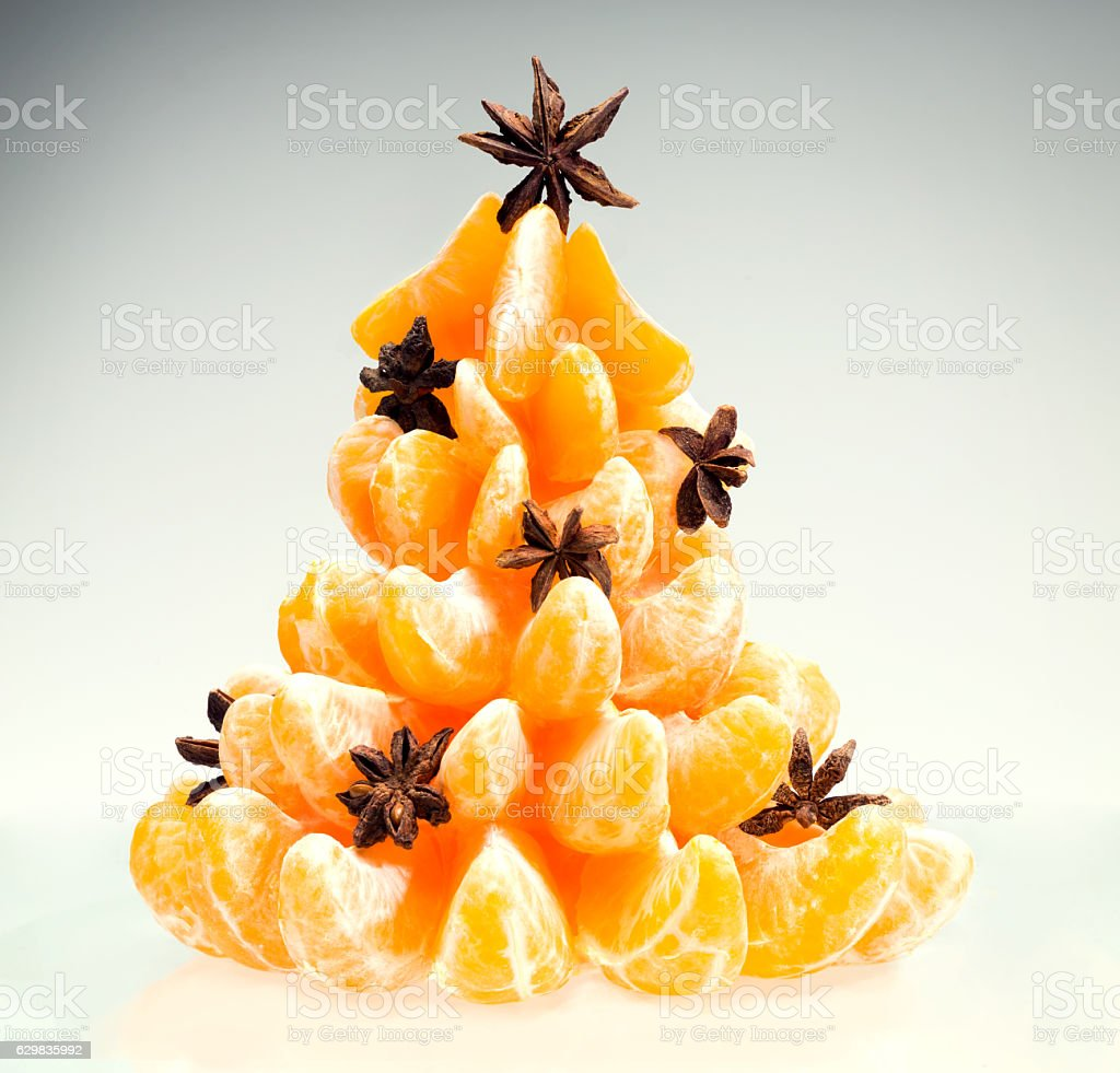 Christmas tree of tangerines with star anise. stock photo