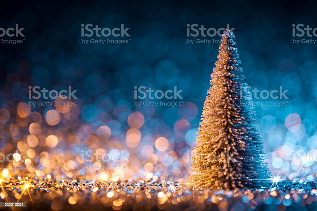 Christmas tree on defocused lights. Decorations Blue Gold stock photo
