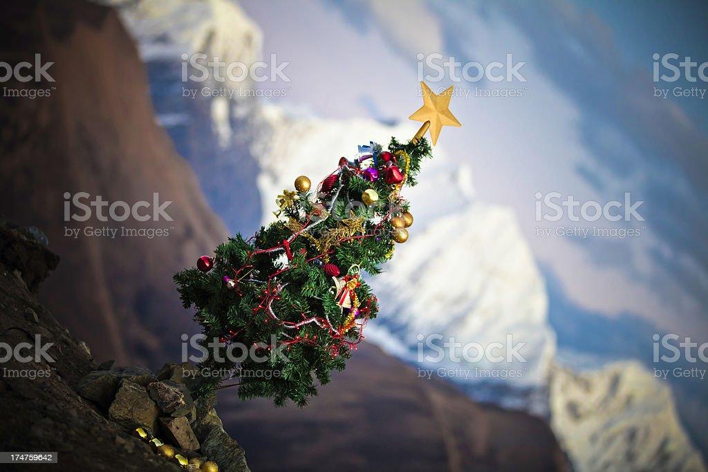 christmas tree on mountainpeak royalty-free stock photo