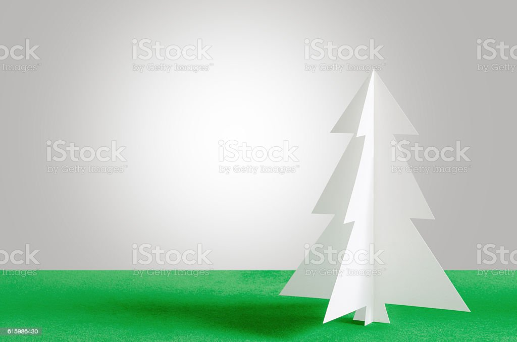 Christmas tree on velvet background. Christmas tree paper. stock photo