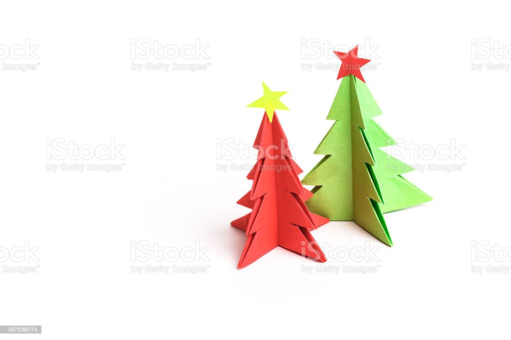 Christmas tree on white isolated origami. stock photo