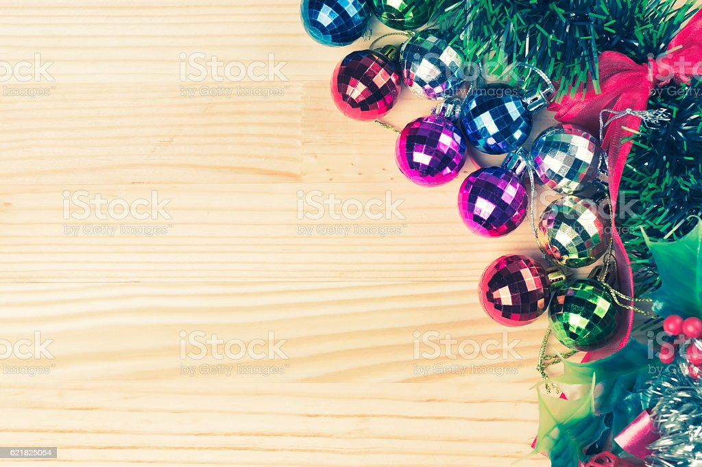 Christmas tree ornaments on natural wooden table. stock photo