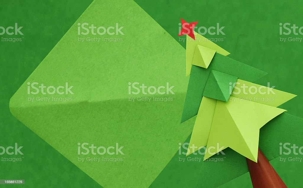 Christmas tree over green background royalty-free stock photo