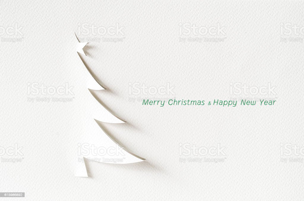 Christmas tree paper cutting design card. stock photo