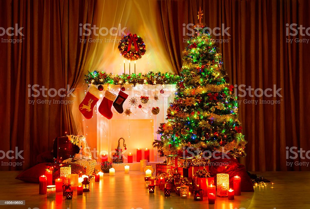 Christmas Tree Room, Xmas Home Night Interior, Fireplace Lights Decoration stock photo