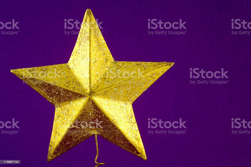 Christmas tree star on purple crepe background royalty-free stock photo