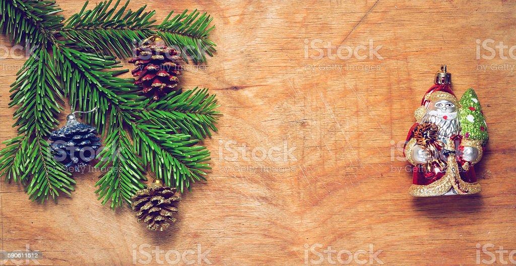 Christmas tree twig and Green Santa Claus stock photo