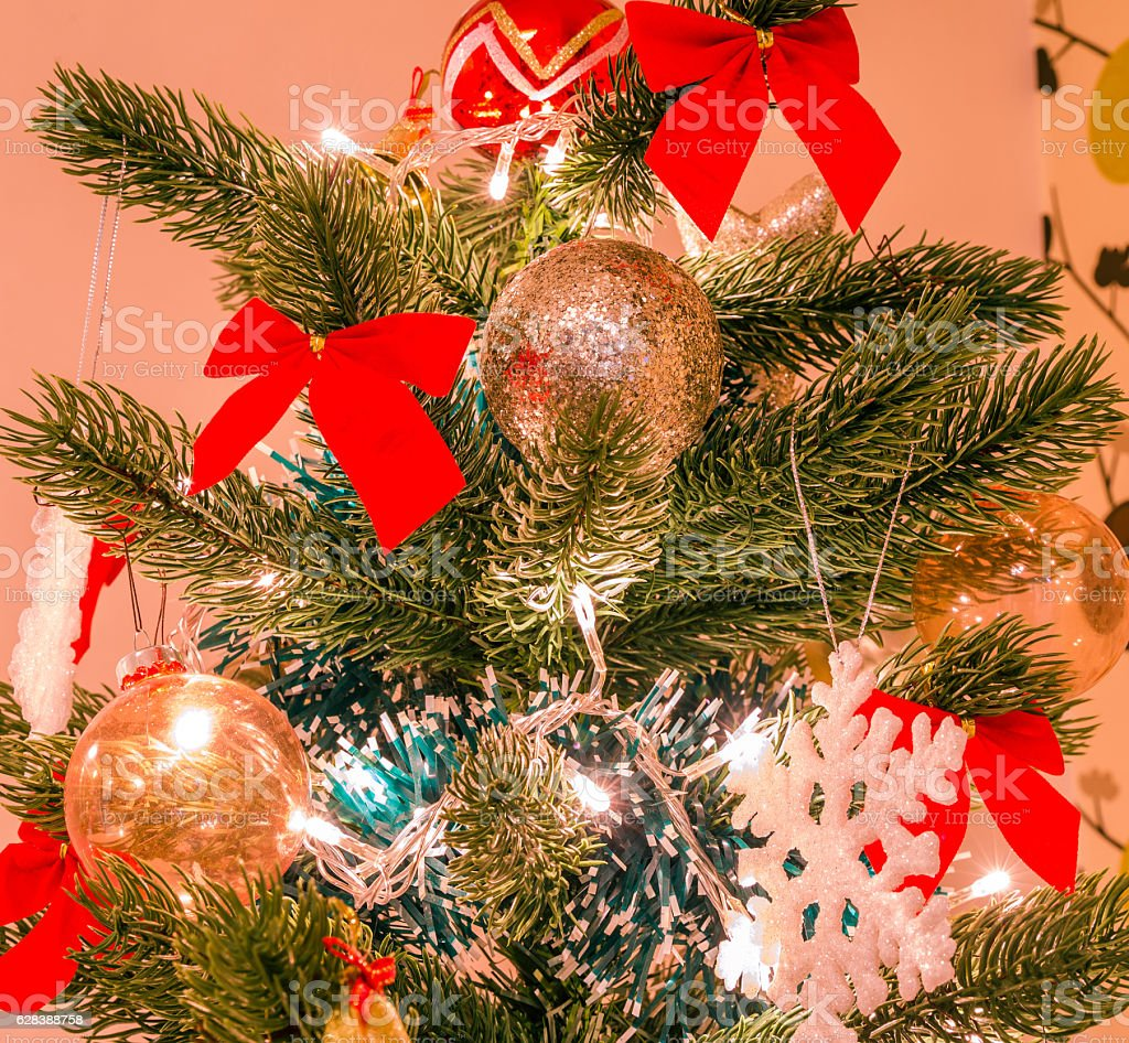 Christmas tree with big snow flake and red bows stock photo