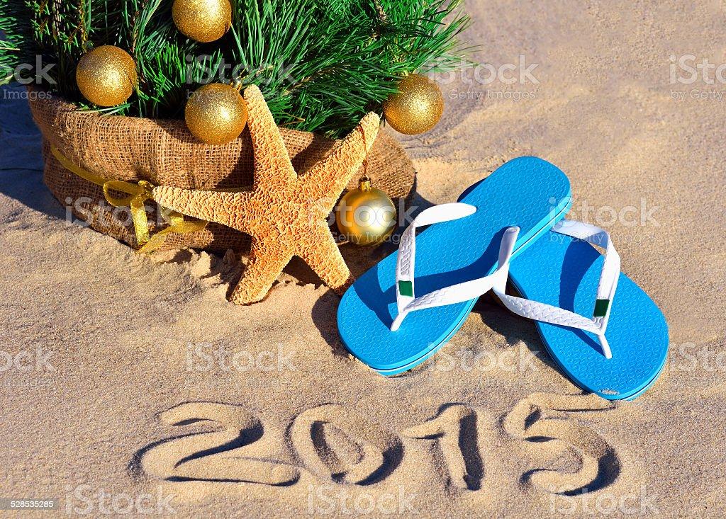Christmas tree with christmas balls, slippers, starfish on beachh stock photo