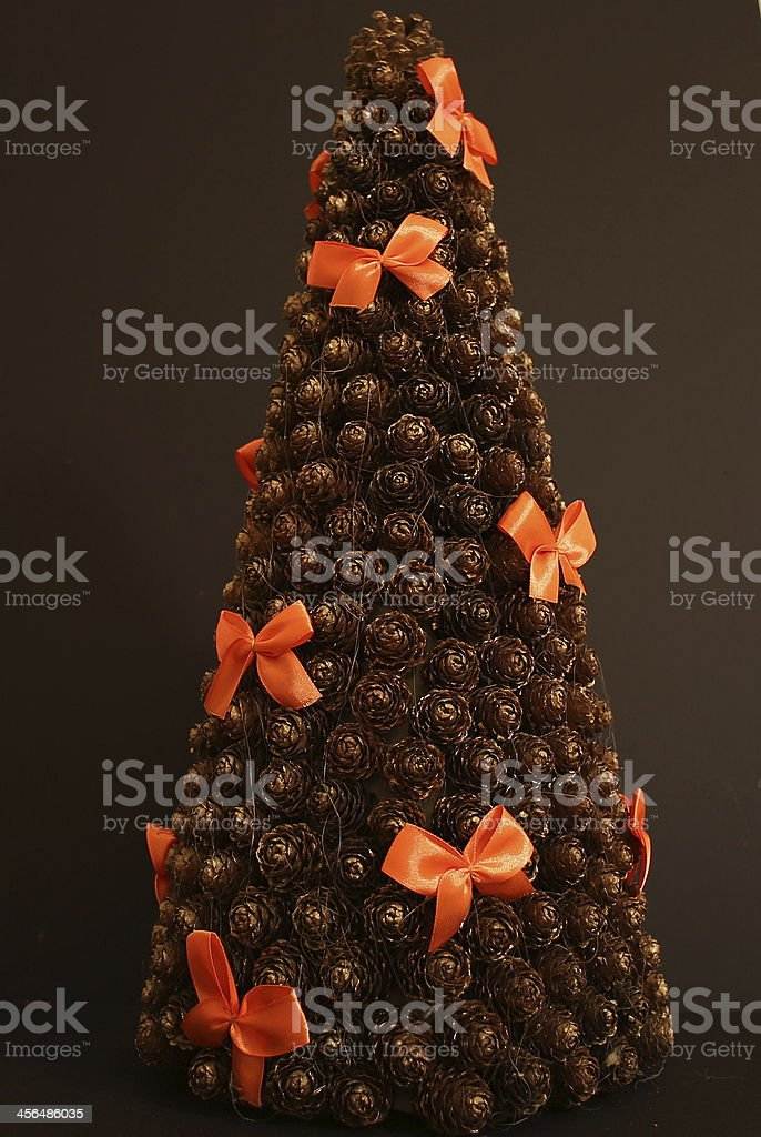 Christmas tree with cones and ribbons royalty-free stock photo