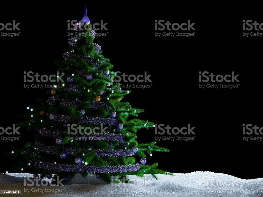 Christmas tree with decorations and snow on isolate black background. stock photo