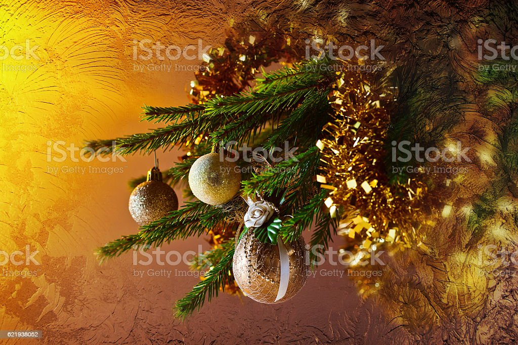 Christmas tree with decorations behind the frozen glass stock photo